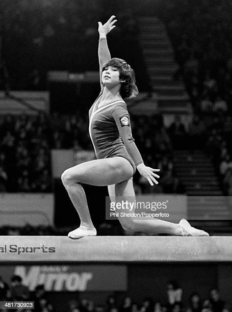 Nellie Kim of the Soviet Union on the balance beam during the Lilia White Gymnastics Championships held at the Wembley Arena in London circa November...