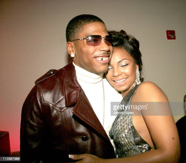 Nelly and Ashanti during Ashanti's 25th Birthday Surprise Party Inside at Glo in New York City New York United States