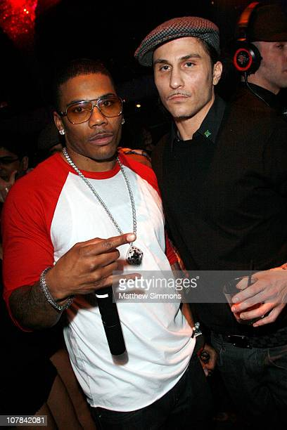 Nelly and Avery Storm attend the Haze Nightclub New Year's Eve party hosted by Nelly at Haze on December 31 2010 in Las Vegas Nevada