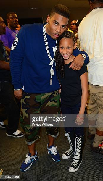 Nelly and DeyJah Harris attend 1079 Birthday Bash 17 at Philips Arena on June 16 2012 in Atlanta Georgia