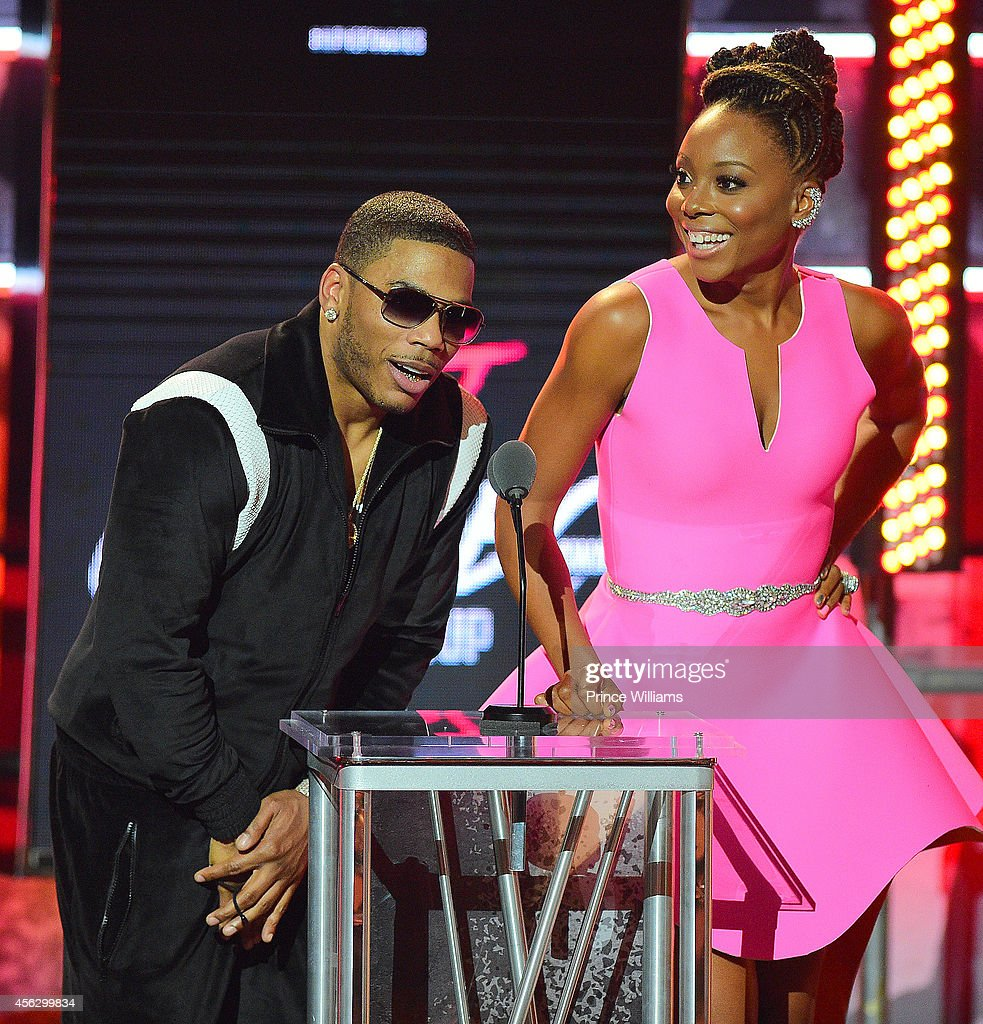 Nelly and Erica Ash onstage at the BET Hip Hop awards at Boisfeuillet Jones Atlanta Civic Center on September 20, 2014 in Atlanta, Georgia.