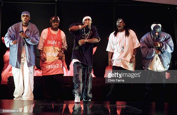 Nelly and his crew, St. Lunatics, perform on stage at the the 2002 Billboard Music Awards.