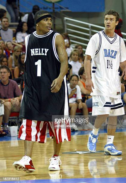 Nelly and Justin Timberlake of 'N Sync during *NSYNC Challenge for the Children IV Celebrity Basketball Game at TD Waterhouse Centre in Orlando...