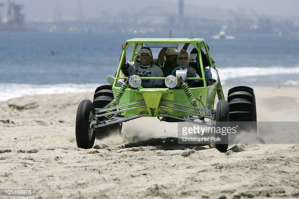 Nelly and Murphy Lee drive a dunebuggy to the MTV Summer on the Run Beach House 2004