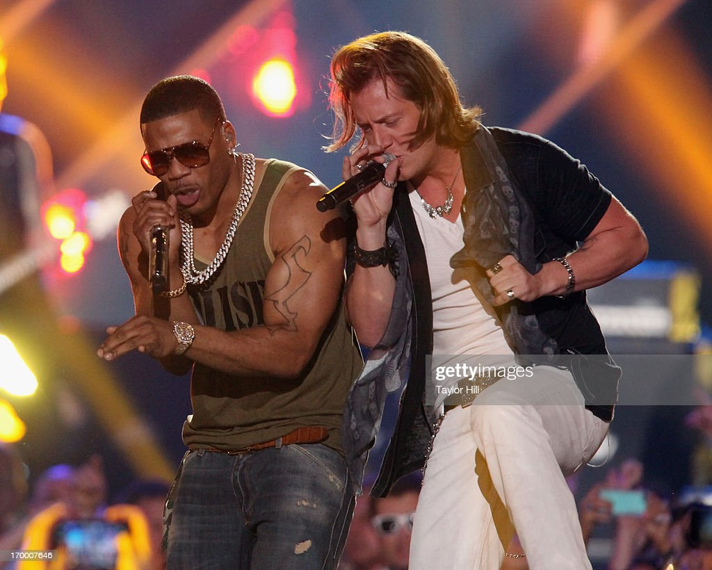 Nelly and Tyler Hubbard of Florida-Georgia Line perform during the 2013 CMT Music awards at the Bridgestone Arena on June 5, 2013 in Nashville, Tennessee.