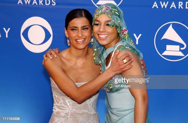 Nelly Furtado and Alicia Keys during The 44th Annual Grammy Awards at Staples Center in Los Angeles California United States