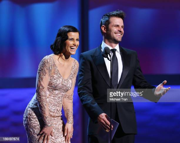 Nelly Furtado and Mark Tacher speak onstage at the XIII Annual Latin Grammy Awards held at Mandalay Bay Events Center on November 15 2012 in Las...