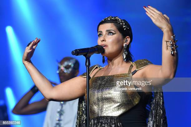 "Nelly Furtado performs on stage at the auction for the inaugural ""Monte-Carlo Gala for the Global Ccean"" honoring Leonardo DiCaprio at the Monaco..."