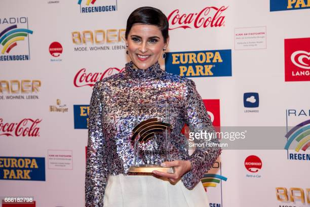 Nelly Furtado poses with her award prior to the Radio Regenbogen Award 2017 at Europapark on April 7, 2017 in Rust, Germany.