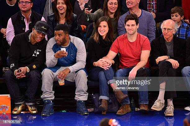 Nelly guest Lia Smith Justin Bartha and Larry David attend the San Antonio Spurs vs New York Knicks game at Madison Square Garden on November 10 2013...