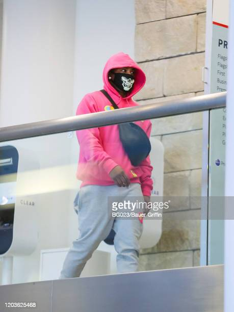 Nelly is seen at Los Angeles International Airport on February 26 2020 in Los Angeles California