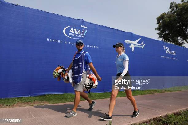 Nelly Korda and her caddie walk to the 18th green during the final round of the ANA Inspiration on the Dinah Shore course at Mission Hills Country...