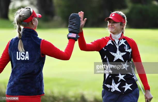 Nelly Korda and Jessica Korda of Team USA high five on the fifth green during Day 1 of The Solheim Cup at Gleneagles on September 13 2019 in...