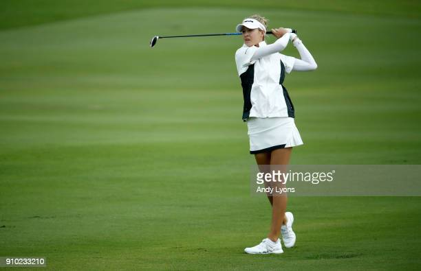 Nelly Korda hits her second shot on the 4th hole during the first round of the Pure Silk Bahamas LPGA Classic at the Ocean Club Golf Course on...