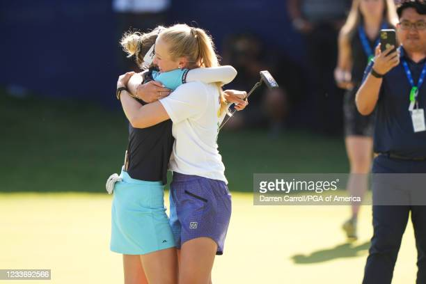 Nelly Korda hugs her sister Jessica Korda after the final round for the 2021 KPMG Women's Championship at the Atlanta Athletic Club on June 27, 2021...