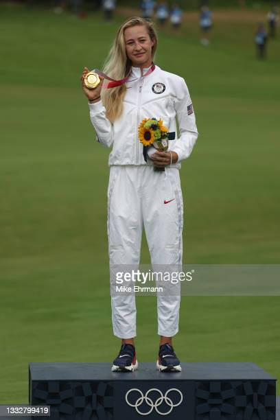 Nelly Korda of Team United States celebrates with the gold medal at the victory ceremony after the final round of the Women's Individual Stroke Play...