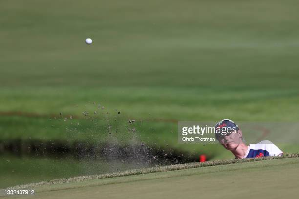 Nelly Korda of Team United States plays a shot from a bunker on the 18th hole during the second round of the Women's Individual Stroke Play on day...