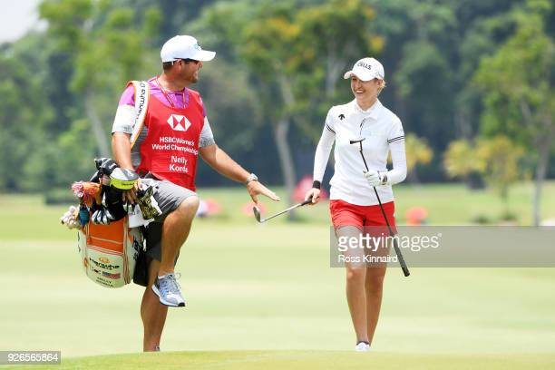 Nelly Korda of the United States and her caddie joke after she chipped onto the 16th green during round three of the HSBC Women's World Championship...