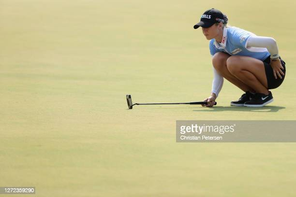 Nelly Korda of the United States lines up her putt on the 18th green during the final round of the ANA Inspiration on the Dinah Shore course at...