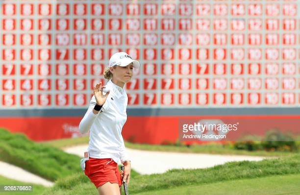 Nelly Korda of the United States reacts on the 18th green during round three of the HSBC Women's World Championship at Sentosa Golf Club on March 3...