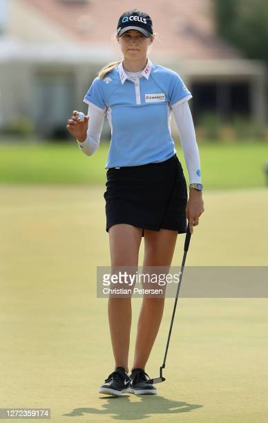 Nelly Korda of the United States reacts to her par putt on the 18th green during the final round of the ANA Inspiration on the Dinah Shore course at...