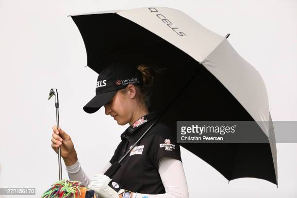 Nelly Korda of the United States takes a club from her bag on the 17th hole during the third round of the ANA Inspiration on the Dinah Shore course...