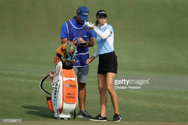 Nelly Korda of the United States takes a club from her bag on the second hole during the final round of the ANA Inspiration on the Dinah Shore course...
