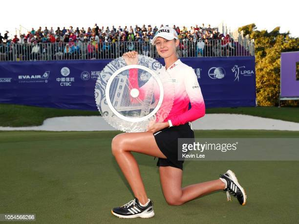 Nelly Korda poses with her trophy on the 18th green after winning the Swinging Skirts LPGA Taiwan Championships at Ta Shee Golf Country Club on...