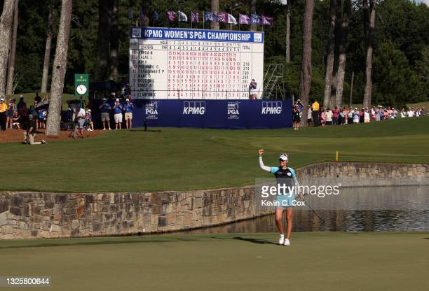Nelly Korda reacts after putting in to win on the 18th green during the final round of the KPMG Women's PGA Championship at Atlanta Athletic Club on...
