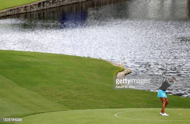 Nelly Korda tees off from the drop zone after hitting into the water on the 15th hole during the final round of the KPMG Women's PGA Championship at...