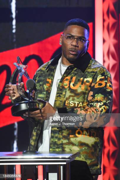 """Nelly speaks onstage after receiving the """"I Am Hip Hop"""" Award during the 2021 BET Hip Hop Awards at Cobb Energy Performing Arts Centre on October 01,..."""