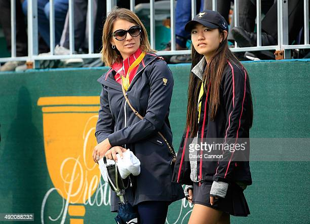NelMare Oosthuizen and Amanda Choi watching the final match during the Saturday morning foursomes matches at The Presidents Cup at Jack Nicklaus Golf...