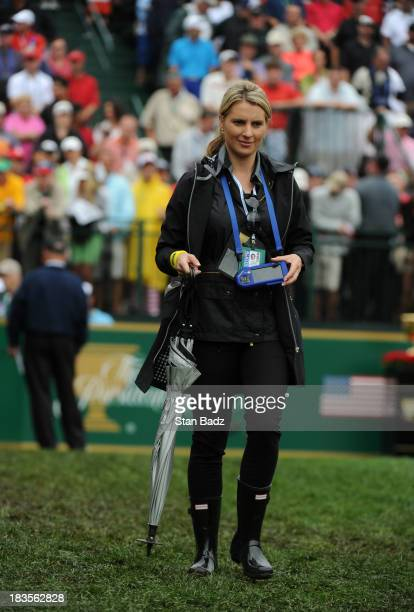 NelMare Oosthuizen wife of Louie Oosthuizen of the International Team follow the play on the first hole during the Final Round Singles Matches of The...