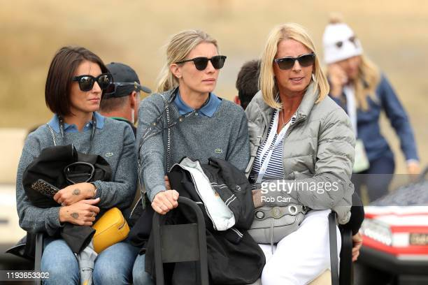 NelMare Oosthuizen wife of Louis Oosthuizen of South Africa and the International team and Marie Kojzar wife of Adam Scott of Australia and the...