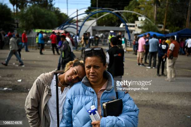 Nelmy Maribel Ponce Hernandez and her daughter Angela Ponce Hernandez both from Honduras stand for a portrait after signing up to return to Honduras...