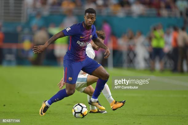 Nelsinho of Barcelona vies for the ball with Borja Mayoral of Real Madrid during their International Champions Cup football match at Hard Rock...
