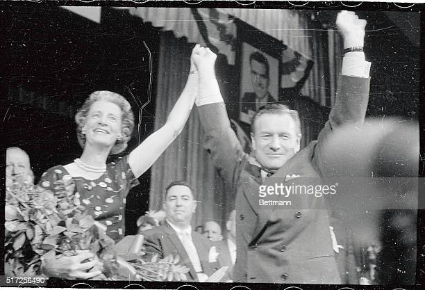 Nelson A Rockefeller and his wife acknowledge the cheer of the crowd after he accepted the nomination of Governor of New York State at the New York...