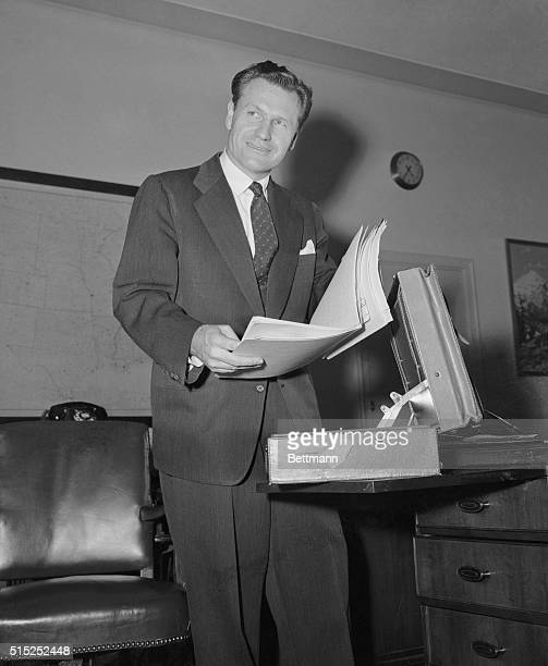 Nelson A Rockefeller sorts papers in his office at the Health Education and Welfare Building as he prepares to take over his White House post as...