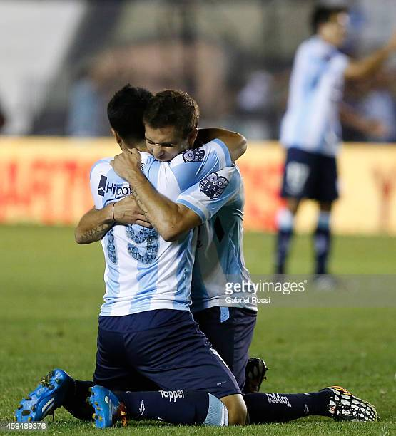 Nelson Acevedo of Racing Club celebrate with teammate Leandro Grimi the own goal scored by Ramiro Funes Mori of River Plate during a match between...