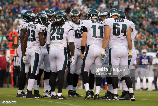 Nelson Agholor LaGarrette Blount Lane Johnson Carson Wentz and Matt Tobin of the Philadelphia Eagles huddle against the Buffalo Bills in the...