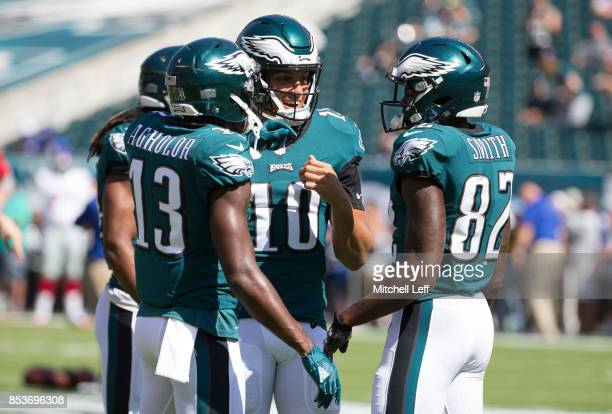 Nelson Agholor Mack Hollins and Torrey Smith of the Philadelphia Eagles huddle prior to the game against the New York Giants at Lincoln Financial...