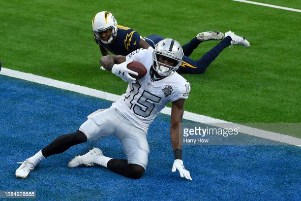 Nelson Agholor of the Las Vegas Raiders makes a third quarter touchdown catch in front Nasir Adderley of the Los Angeles Chargers of at SoFi Stadium...