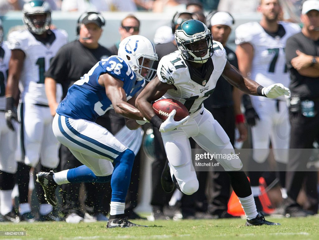 Nelson Agholor #17 of the Philadelphia Eagles catches the ball and then runs past Deveron Carr #38 of the Indianapolis Colts on August 16, 2015 at Lincoln Financial Field in Philadelphia, Pennsylvania. The Eagles defeated the Colts 36-10.