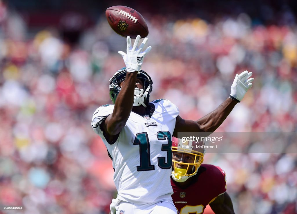 Nelson Agholor #13 of the Philadelphia Eagles completes a touchdown pass over O.J Swearringer #36 of the Washington Redskins in the second quarter at FedExField on September 10, 2017 in Landover, Maryland.