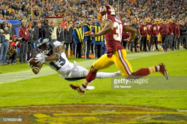 Nelson Agholor of the Philadelphia Eagles dives for a touchdown in front of Fabian Moreau of the Washington Redskins during the second half at...