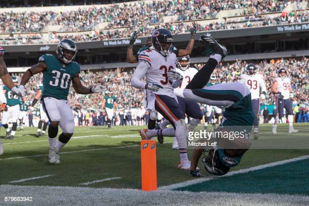 Nelson Agholor of the Philadelphia Eagles flips into the end zone past Eddie Jackson of the Chicago Bears to score a touchdown in the second quarter...