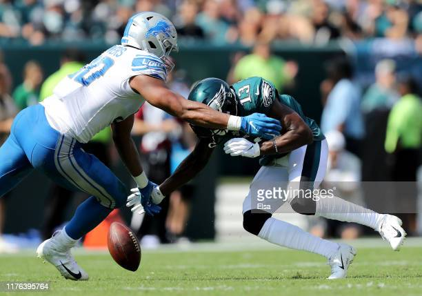 PHILADELPHIA PENNSYLVANIA SEPTEMBER 22 Nelson Agholor of the Philadelphia Eagles fumbles the ball as Trey Flowers of the Detroit Lions defends in the...