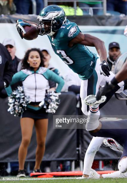 Nelson Agholor of the Philadelphia Eagles heads for the endzone as Eddie Jackson of the Chicago Bears defends in the second quarter on November 26...