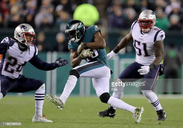 Nelson Agholor of the Philadelphia Eagles makes a catch as Ja'Whaun Bentley and Jordan Howard of the New England Patriots defend at Lincoln Financial...