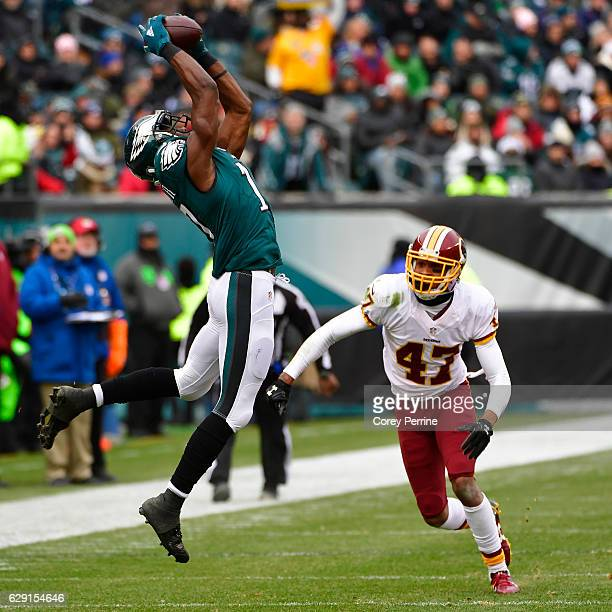 Nelson Agholor of the Philadelphia Eagles makes a reception in the first quarter as Quinton Dunbar of the Washington Redskins looks on at Lincoln...